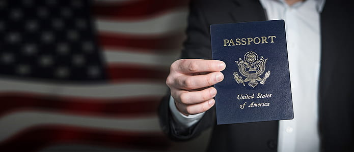person holding passport of United States of America