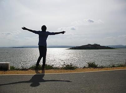 person standing near body of water \