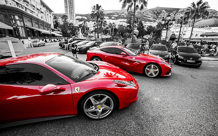 selective photo of two red sport coupes