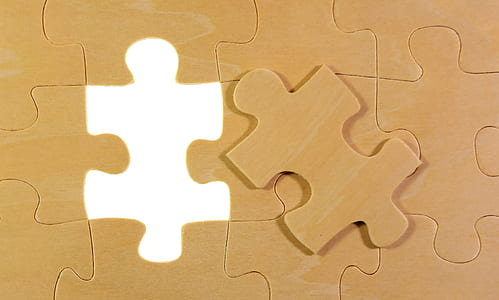 brown jigsaw puzzle piece