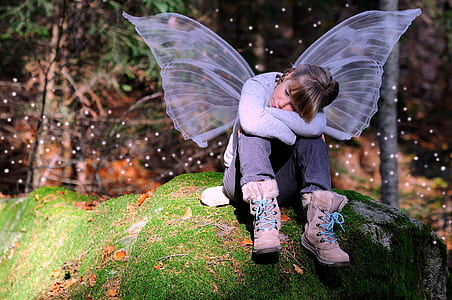 girl with butterfly wings sitting on a rock photography