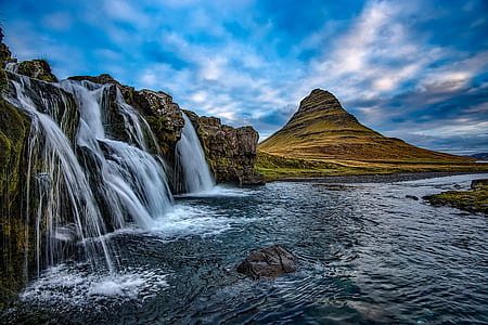 landscape photography of waterfalls and green mountain