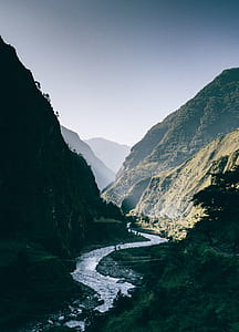 river in between mountains during daytime