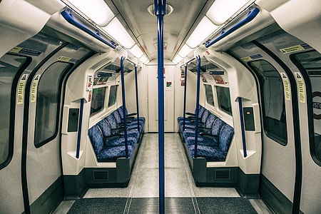 Wide-angle shot of the interior of a train on the London Underground