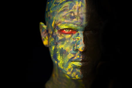 man's face full of paints