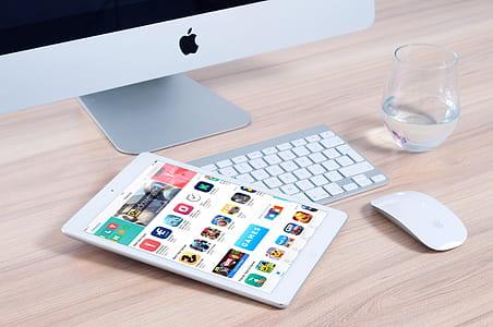 white iPad mini on silver Apple keyboard