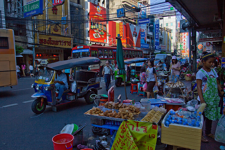 Urban photo of the busy streets of the Chinatown district of Bangkok in Thailand