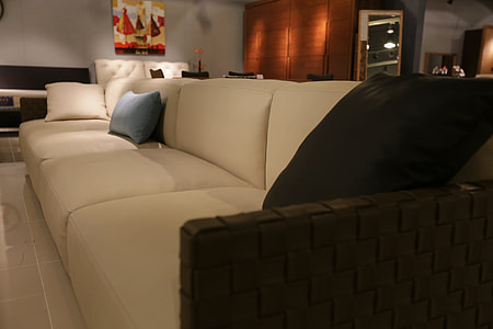 photography of a white leather couch