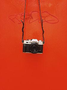 black and silver Fujifilm SLR camera