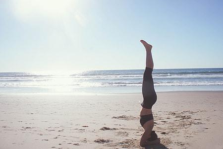 Yoga stand on beach