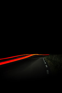 black and orange time lapsed photography during nightime