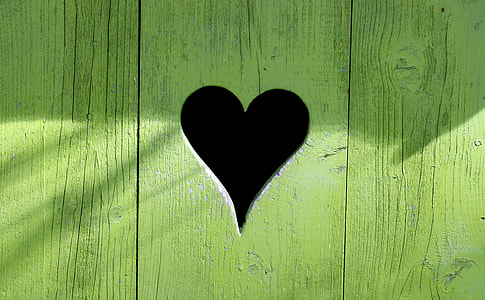 green wooden heart-cutout decor