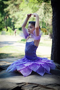 girl wearing purple ballet dress at daytime