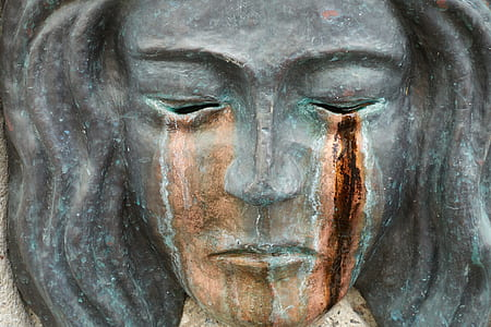 female statue's face