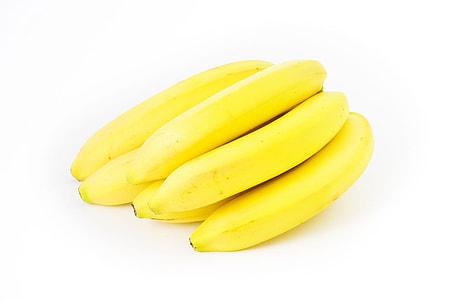 yellow bananas on white surface