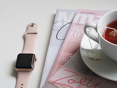 Apple Watch beside white ceramic teacup