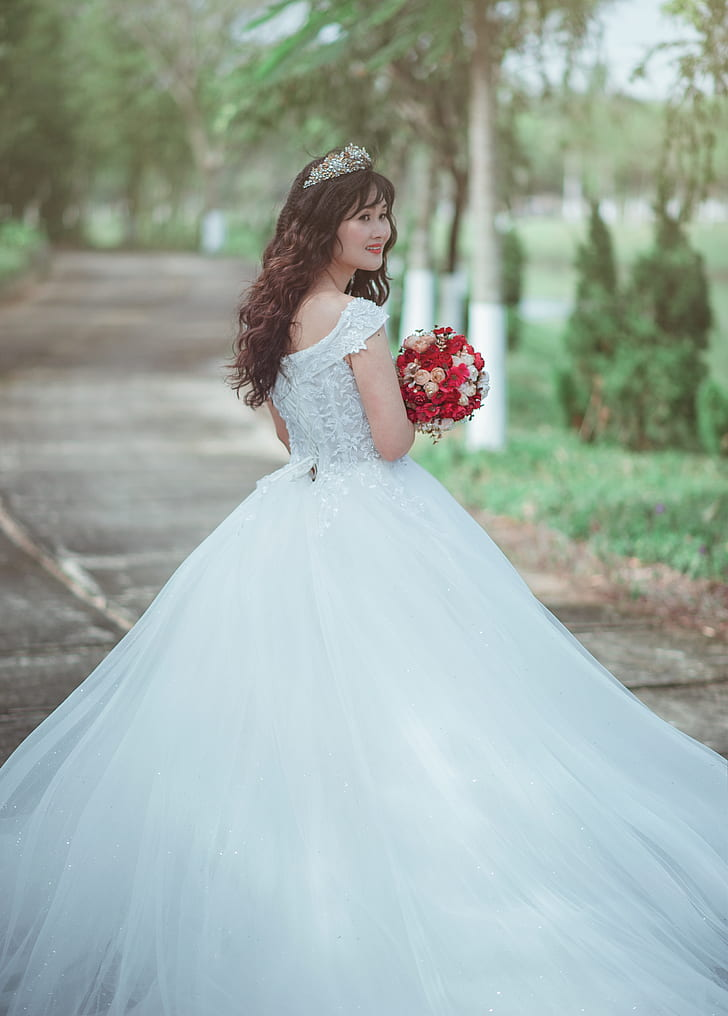 Royalty Free Photo Woman In White Wedding Dress Holding Red