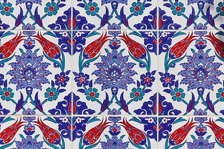 close up photo of purple and red floral tiles