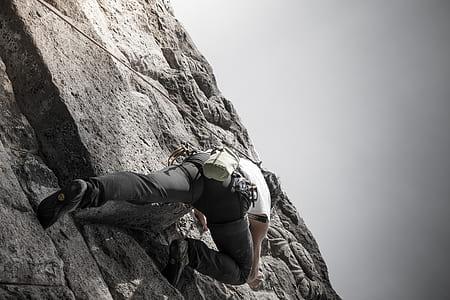 man wall climbing during daytime