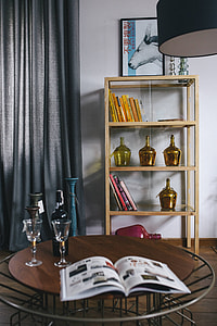 Stylish home decor with a wooden round table and a bookcase
