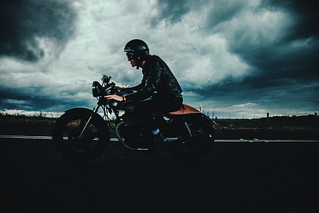 Man riding his motorbike on the road