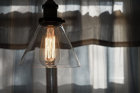 clear glass pendant lamp turned on