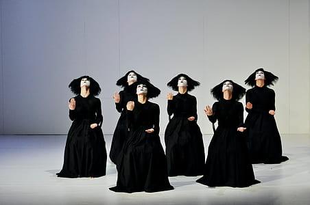 women wearing black dress dancing