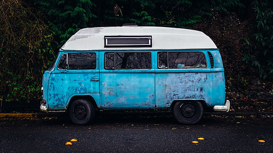 photography of vintage blue van on street