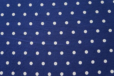 blue and white polka-dot textile