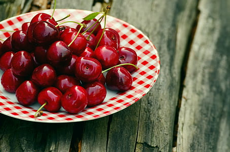 red cherries on plate