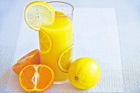 closeup photo of orange juice with fruit