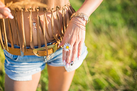 Happy Girl Showing a Daisy in Her Hands