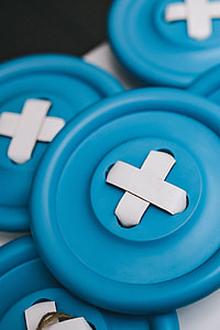Close-ups of big blue plastic buttons