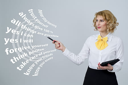woman wearing white dress shirt with text overlay