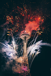 Space Needle with fireworks during night time