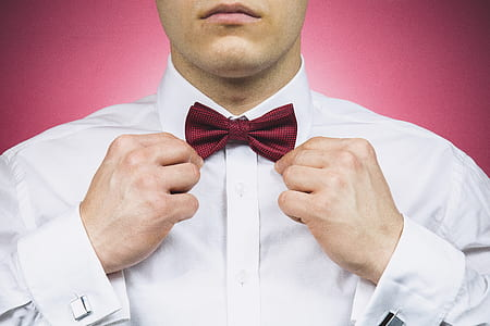 man holding red bow tie