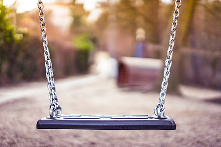 Swing For Kids in City Park Playground