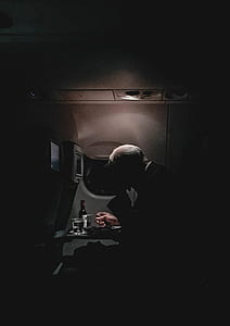 man sitting inside the plane photo