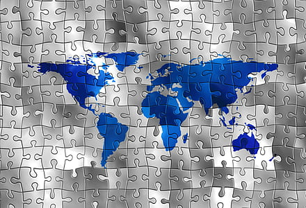 blue and gray world map puzzle piece