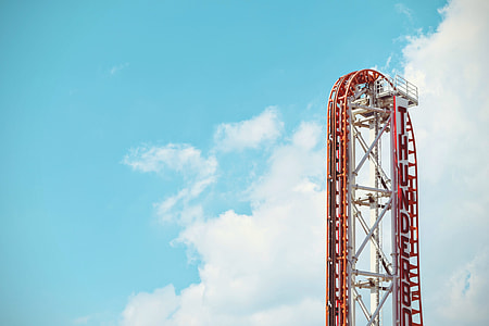 red and white roller coaster during day time