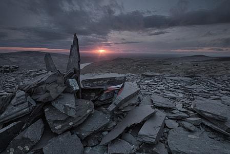 pile of gray rocks during sunset