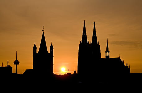 silhouette of cathedral with sunset background