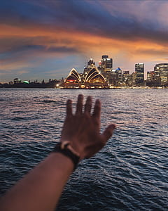 photo of person reaching Sydney, Opera House