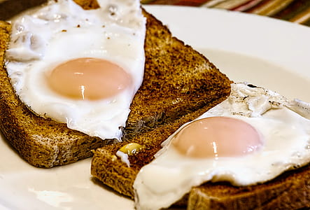 two sunny sideup egg on brown breads