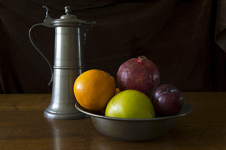 gray bowl of fruits and teapot