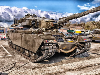 close-up photography of battle tank near trees