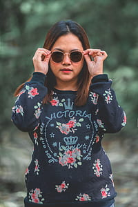 woman wearing black and red floral Victoria long-sleeved shirt