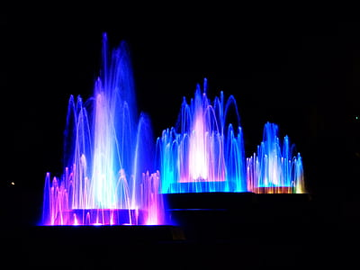 fountains with blue and purple lights