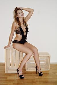 woman in black one-piece swimwear posing for photo