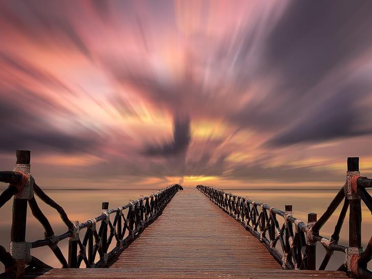 timelapse photo of wooden bridge during golden hour
